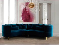 Margret Sofa - Featuring a show-stopping deep blue #velvet over brass feet, this sofa is guaranteed to bring old #Hollywood #glamour and grandeur to your living room.