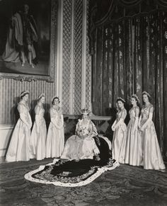 Queen Elizabeth II with her Maids of Honour  Cecil Beaton  2 June 1953   V & A   In selecting six Maids of Honour instead of pages to bear her velvet train throughout the Coronation ceremony, the Queen followed the precedent of Queen Victoria. From left to right, they were:  Lady Moyra Hamilton (now Lady Moyra Campbell), Lady Anne Coke (now The Rt Hon The Lady Glenconner), Lady Rosemary Spencer-Churchill (now Lady Rosemary Muir), Lady Mary Baillie-Hamilton (no...