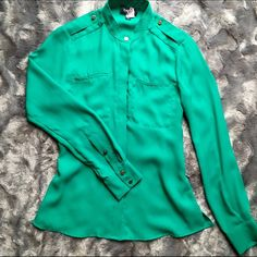 Bebe Deep Green Blouse Bebe blouse in almost new condition!  Has only been worn once and has been recently cleaned.  Made of 100% polyester.   Color is a deep green w gold hardware details.  True to size.   Great top that can be worn w skirts, dress pants or jeans bebe Tops
