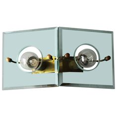 Italian Brass and Cut-Glass Sconce by Arredoluce
