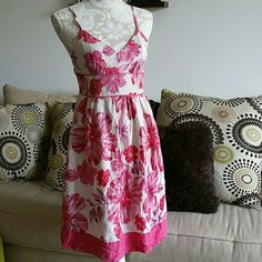 """Guess silk floral dress Beautiful 100% silk dress from Guess. Adjustable shoulder straps. Zipper back. Polyester and cotton lining. Measures 34"""" from top of shoulder strap. Bust measures 15"""" waist is 14"""". Small stitching pull shown in second pic. Guess Dresses"""