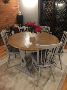 Priory oak table and chairs. Table sanded and top stained with French oak. Base and chairs painted with Rustoleum 'flint' then varnished