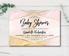 A modern, elegant geometric gold and blush marble baby shower invitation, perfect for celebrating the impending arrival of a baby girl!