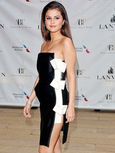 Selena Gomez is all tied up at the American Ballet Theatre Spring Gala in New York City in a bow-tied black and white dress. http://www.people.com/people/gallery/0,,20815953,00.html#30154018