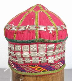 """Turkmen Girl's Hat, Silk Embroidery on Cotton with Silver Ornaments, 7"""" x 7"""", Northern Afghanistan  The design of the hat has clearly been inspired by the trellis structure of a yurt."""