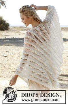 """Knitted DROPS poncho worked sideways with textured pattern in """"Alpaca Bouclé"""", """"Vivaldi"""" and """"Lace"""". Size: S - XXXL. Free pattern by DROPS Design."""