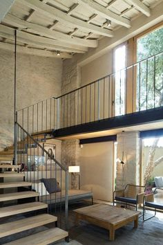 contemporary metal stair, ancient building - barn conversion styling