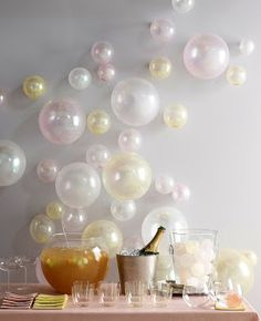 Balloons in different sizes taped to a wall for decoration.