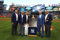 Derek Jeter Photos Photos - Derek Jeter poses with his former teamates Andy Pettitte, Mariano Rivera, Jorge Posada, and Bernie Williams  during the retirement ceremony of his number 2 jersey  at Yankee Stadium on May 14, 2017 in New York City. - Derek Jeter Ceremony