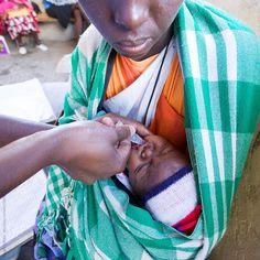 Stock photo of Baby receiving vaccine. by hughsitton Baby Photos, Couple Photos, Kenya, Clinic, Africa, Medical, The Unit, Stock Photos, Couples