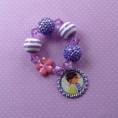 Doc McStuffins Chunky Stretch Bracelet. Also check out my shop for more ideas www.partiesandfun.etsy.com