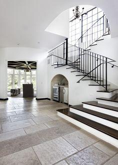 love the floor tile, staircase, high ceiling.    Austin, TX