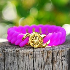 You will love this new neon magenta Madi with a gold plated stainless steel lock closure. The silicone bracelet will definitely add more brightness to your summer! One size fits most.