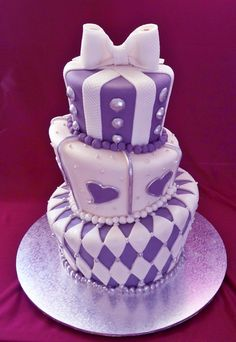 the bride wanted a silver and purple topsy turvey wedding cake , i like it because its a bit quirky but still very elegant www.elisabethscakes.com.au