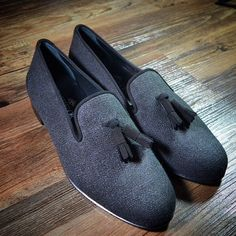 Black and grey loafers with the tassels