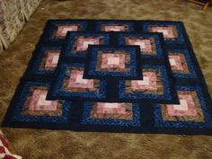 """Outside the box"" quilt. I would change the colors, but the pattern is great."