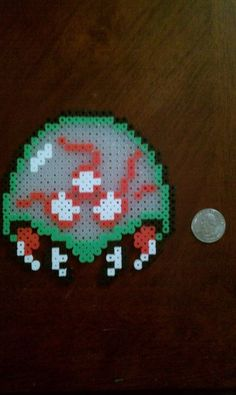 Perler Beads; a Metroid, from the NES game of the same name.