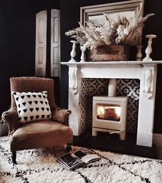 Lots of warm and texture in my living room with a cream Skye woodburner from Charnwood, a vintage chair and monochrome cushion and rugs as well as a pampas grass display on the mantelpiece Hygge Living Room, Boho Interior, Blue Interior Paint, Dark Interiors, Interior Design, Interior, Interior Design Boards, Home Decor, Furniture Decor