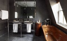 Amazing bathroom.. metal sink paired with a wooden tub!