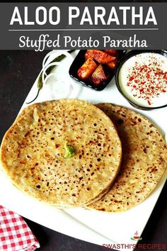 Aloo paratha are Indian breakfast flatbreads stuffed with spiced potatoes. These stuffed parathas are super delicious and go well with a pickle or yogurt. #breakfast #indian #paratha via @swasthi Potato Recipes, Beef Recipes, Vegetarian Recipes, Snack Recipes, Cooking Recipes, Cooking Dishes, Vegetable Recipes, Healthy Recipes, Indian Breakfast