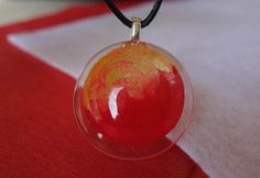 Red and Gold Painted Swirl hand painted circular resin pendant