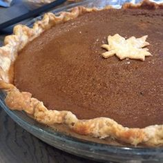 Mom's Pumpkin Pie - Allrecipes.com   in the magazine, this recipe has been modified.  no extra egg yolk, salt reduced to ½ tsp, milk reduced to 1 cup, chill crust for an hour in pie plate, Lay a piece of foil slightly larger than pie plate on lower rack to catch drips.  Bake at 425º for 15 min, reduce heat as in this recipe.  Chocolate Pumpkin Pie, omit ginger and nutmeg, add ¼ tsp ground allspice, increase cinnamon to 1 tsp Melt 1 c choco chips, fold into pumpkin mixture, bake as directed