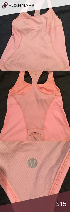 Lululemon size 6 baby pink shirt Re-posh as I don't really rock pastels. Great condition and deserves to be worn. More pink in person but my lighting sucks :( check my closet for other lulu items lululemon athletica Tops Tank Tops
