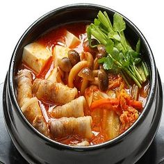 If there's one soup that epitomizes soul-sustaining warmth for me, it's the Korean staple, kimchi jjigae. Kimchi Jigae Recipe, Meals For Four, Korean Dishes, Korean Food, Seafood Stew, Yum Yum Chicken, Yummy Appetizers, Seafood Recipes, Tofu