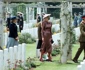April 28, 1985: Prince and Princess Diana walking through grave stones before a ceremony at the Anzio Beach Head cemetery. The Princess wears a wine coloured silk dress and the Prince the uniform of the Gordon Highlanders.