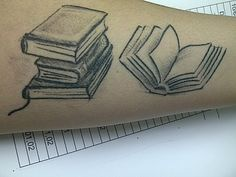 This tattoo belongs to Lisa Leandro:    The tattoo is pretty self explanatory. I love to read. This is my first literary tattoo and there will be more to come.