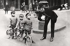Police officer giving directions to three boys with a three person bicycle pointing in the opposite., Stock Photo, Picture And Rights Managed Image. Women's Cycling Jersey, Cycling Art, Cycling Quotes, Cycling Jerseys, Police Sergeant, Police Officer, Couple In Car, Crying Kids, Rules For Kids
