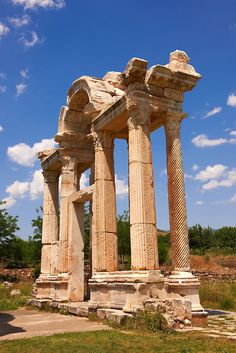The double Tetrapylon Gate, Aphrodisias, Turkey. A tetrapylon (Greek: Τετράπυλον, four gates) is an ancient type of Roman monument of cubic shape, with a gate on each of the four sides: generally it was built on a crossroads.