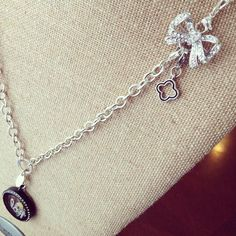 More Origami Owl innovation!  Our bow locket holder fits into the Over the Heart Chain!  Love some cute, new ideas!!!
