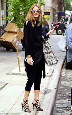 Fashion favourite: The 29-year-old wore an all black ensemble made up of a knitted jumper ...