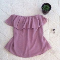 Dusty rose flowy strapless blouse Super cute Fora strapless top with a single ruffle on top that gives a casual girly vibe can be dressed up or down  loose fit and lightweight fabric. Color is a dusty purple rose with a tint of pink- very pretty in person  size medium but can fit small-large as well due to loose fit. feel free to make offers! Fora Tops Blouses