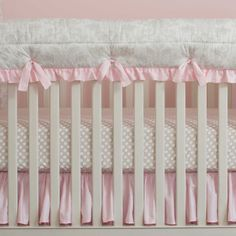 "French Gray and Pink Damask Crib Rail Cover with Ruffle | Carousel Designs.  A perfect solution to help protect your baby's crib while maintaining a stylish decor for your nursery. Our Crib Rail Cover is reversible, enabling you to change the visible side at a moment's notice. Simply wrap the cover around your crib rail, pull the ties though the buttonhole and tie. The crib rail cover measures approximately 50"" long by 18"" wide. Each cover is quilted using batting made with recyclable…"