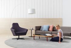 Goodwood table and Paloma armchair are sophisticated additions to your living space. Designed by Doshi Levien for Schiavello.