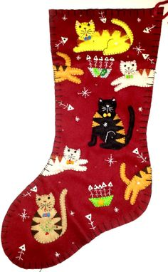 """This 18 inch Kitty Cat Stocking is 100% hand sewn with traditional blanket stitching methods. I've used wool felt, thread and seed beads to create this beautiful holiday stocking. The stocking measures approximately 18"""" from top to bottom.  The stocking features seven jumping cats of assorted colours. Each cat has a different coloured bowtie and can be seen in various sitting or jumping positions! Fish bone and snowflakes embellish the stocking"""