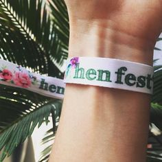 Our HENFEST  satin wristbands are the coolest accessory for your hen party this summer. They have a pink and green floral print with HENFEST in green on a white satin band.   Bring a touch of Coachella or Glastonbury to your glamping or city hen party with these pretty bands. Layer with bangles and bracelets with a festival dress code for the coolest hen party ever and are a great keepsake for after the hen party.