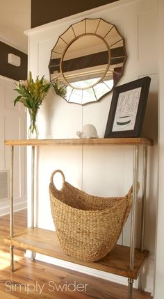 Great side table made from butcher block counters and electric conduit tubing. I love it!