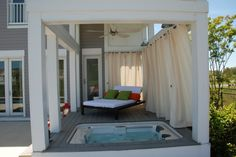 Hmmm - curtains to afford privacy to a spa? Maybe we could do this with army canvas for a hot tub?