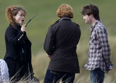 """Bellatrix performing a spell on Harry as he laughs: 