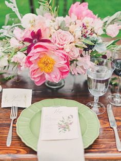 Mint-colored ceramic plates with scalloped edges were the perfect choice for a pastel tablescape inspired by vintage botanical prints. | Photo by Mollie Crutcher | Floral deign by Jaclyn Journey