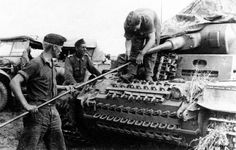 wo Panzerschützen are cleaning the barrel of their up-gunned & up-armored Panzer III Ausf. F from 16. Pz.-Div.