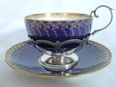 Mintons tea cup & saucer in silver holder