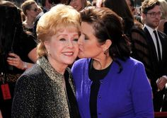 """FILE- In this Sept. 10, 2011, file photo, Debbie Reynolds, left, and Carrie Fisher arrive at the Primetime Creative Arts Emmy Awards in Los Angeles. Reynolds, star of the 1952 classic """"Singin' in the Rain"""" died Wednesday, Dec. 28, 2016, according to her son Todd Fisher. She was 84. (AP Photo/Chris Pizzello, File): Debbie Reynolds and Carrie Fisher in 2011"""