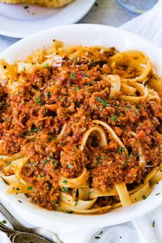 We should have posted The Secret to Authentic Italian Bolognese Sauce Recipe last year after we returned from Italy, but better late than never! You're going to love this rich, meaty sauce! #PASTA #bolognese #Italian #Italianrecipe #Italianfood #pastarecipe #spaghettisauce #ragusauce #familyfriendly #easyrecipe #familyrecipe #easydinnerrecipe #dinnerrecipe Sauce Recipes, Beef Recipes, Cooking Recipes, Healthy Recipes, Cooking Kale, Pizza Recipes, Beste Bolognese, Italian Dishes, Al Dente