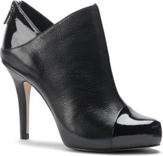 Love the leather/patent leather look and cut of this shoe.    Cherie - Isola Shoes