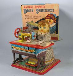 Nomua Dolly Dressmaker. Battery Operated tin toy from 50s/ebay