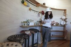 Inside the kitchen of a silo house (love the tractor seat bar stools)